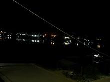 夜の船着き場とメコン川